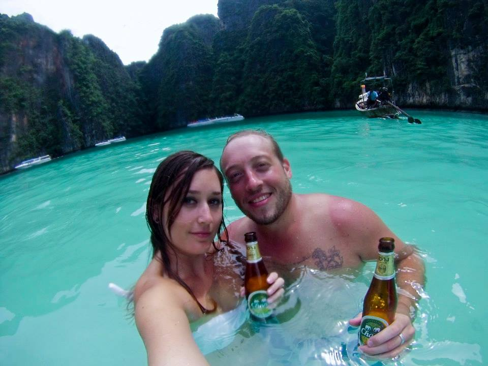 Jeff and Marina of Latitude 34 with a Chang in Maya Bay in Phi Phi, Thailand.