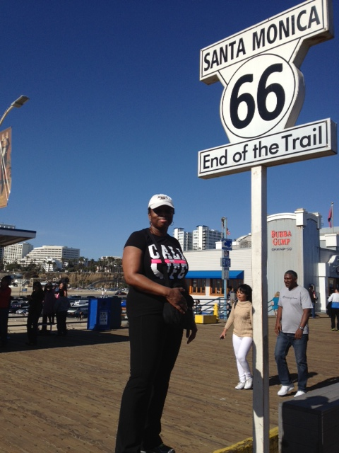 Natina Harris outside the end of Route 66, USA.