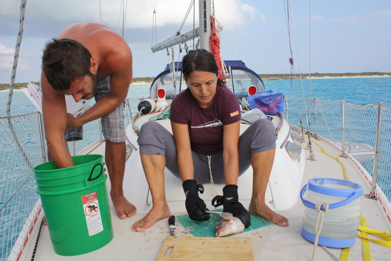tasha gutting a fish on hideaway in the bahamas