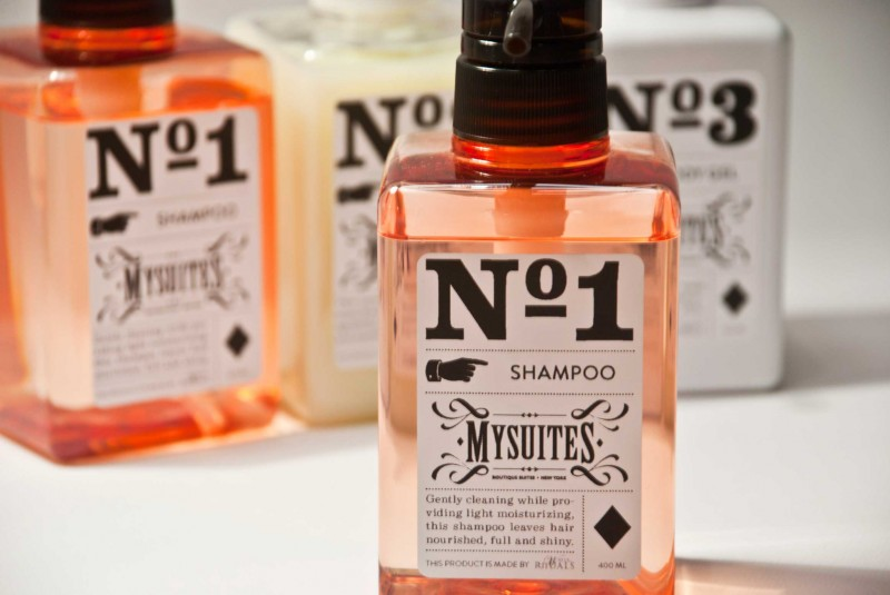 Artfully packaged shampoo, conditioner and body wash gel.