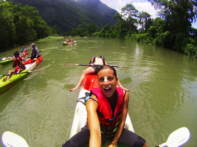 Lazy kayaking down a river in Laos.