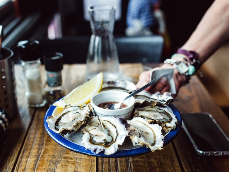 Taste freshly shucked local oysters