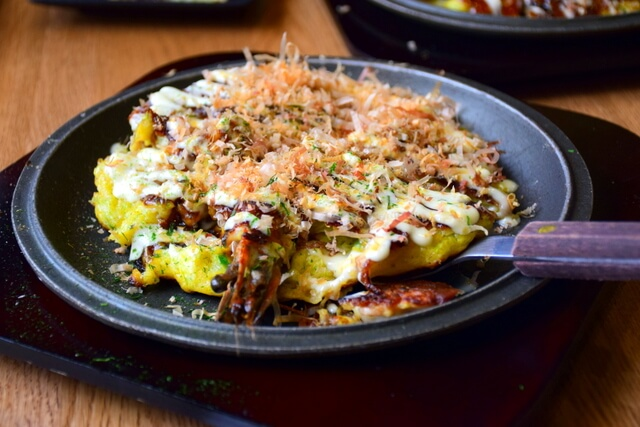 One dish you shouldn't miss in Osaka is okonomiyaki.