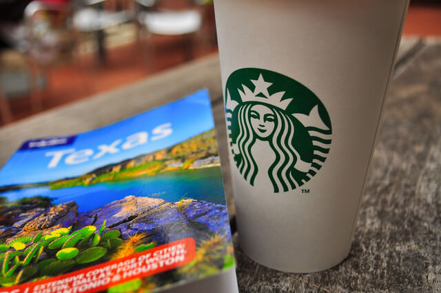 Texas travel guidebook with coffee
